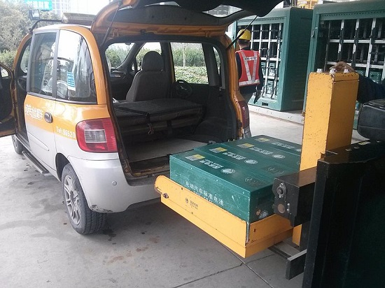 Batteries are a major component in electric vehicles, here a battery is being swapped